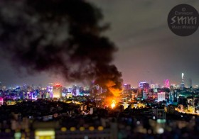 Fire! Glowing neon lights exploding into flames in Ho Chi Minh City's District 3